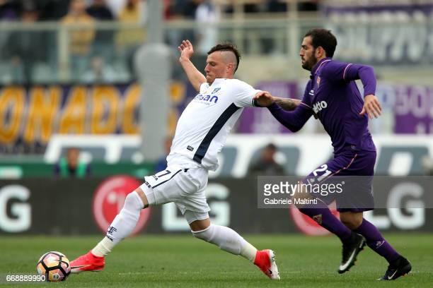 Marcel Buchel of Empoli FC in action agains Riccardo Saponara of ACF Fiorentina during the Serie A match between ACF Fiorentina and Empoli FC at...