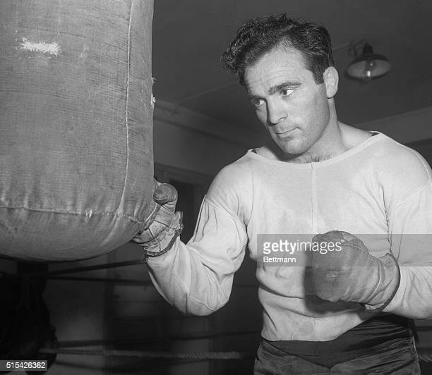 Marcel Cerdan French middleweight champion punches the big bag at his camp just outside of Paris where he is training for his fight June 21 with...
