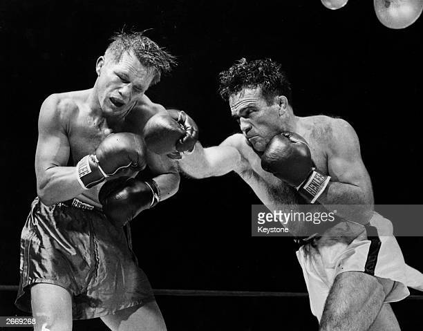 Marcel Cerdan of France delivers a hard right to American boxer Tony Zale's face during their World Middleweight Championship bout at the Roosevelt...