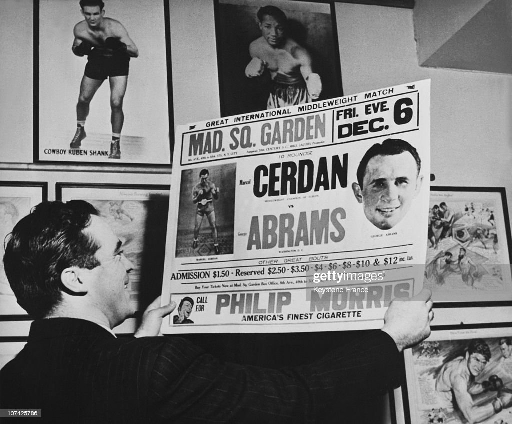 Marcel Cerdan Presenting The Poster Of His Fight Against Abrams At New York In Usa On November 24Th 1946