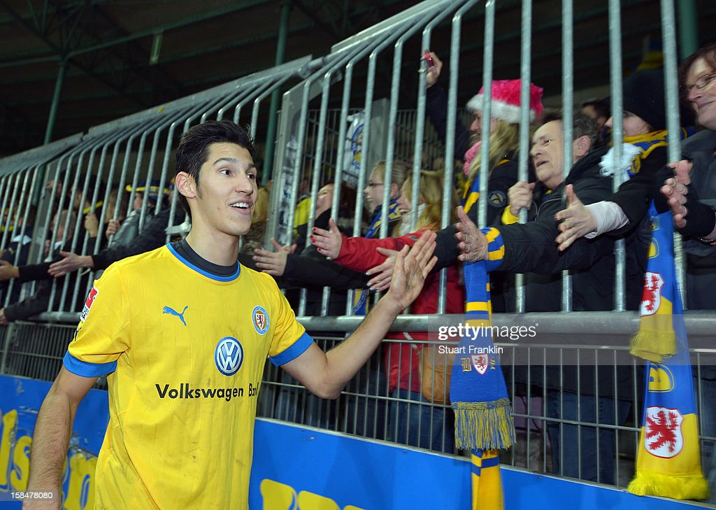 Marcel Correia of Braunschweig celebrates with the fans at the end of the Second Bundesliga match between Eintracht Braunschweig and1. FC Union Berlin at the eintracht stadium on December 17, 2012 in Braunschweig, Germany.