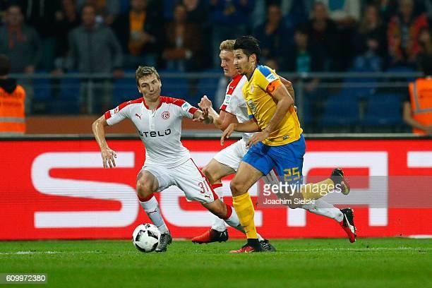 Marcel Correia of Braunschweig challenges Marcel Sobottka and Axel Bellinghausen of Duesseldorf during the Second Bundesliga match between Eintracht...