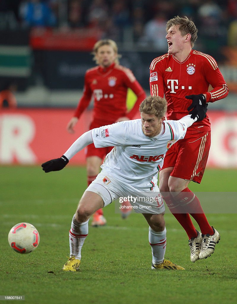 Marcel de Jong (L) of Augsburg fights for the ball with <a gi-track='captionPersonalityLinkClicked' href=/galleries/search?phrase=Toni+Kroos&family=editorial&specificpeople=638597 ng-click='$event.stopPropagation()'>Toni Kroos</a> of Bayern during the Bundesliga match between FC Augsburg and FC Bayern Muenchen at SGL Arena on December 8, 2012 in Augsburg, Germany.
