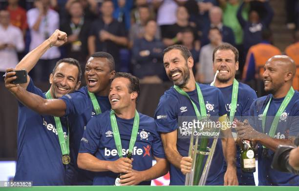 Marcel Desailly takes a photograph as France celebrate their victory after the Star Sixes final football match between France and Denmark at the O2...