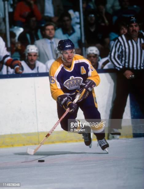 Marcel Dionne of the Los Angeles Kings skates with the puck during an NHL game against the New York Islanders circa 1986 at the Nassau Coliseum in...