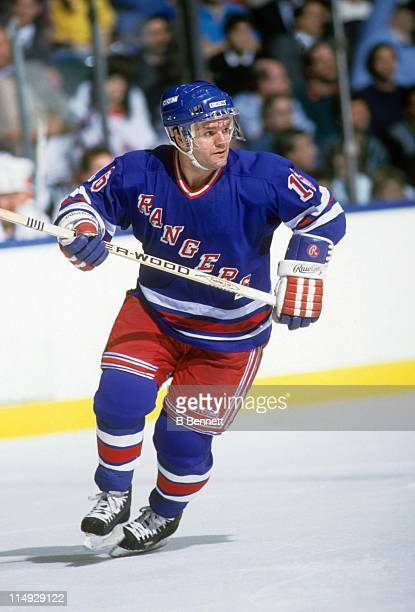 Marcel Dionne of the New York Rangers skates on the ice during an NHL game against the New York Islanders circa 1988 at the Nassau Coliseum in...