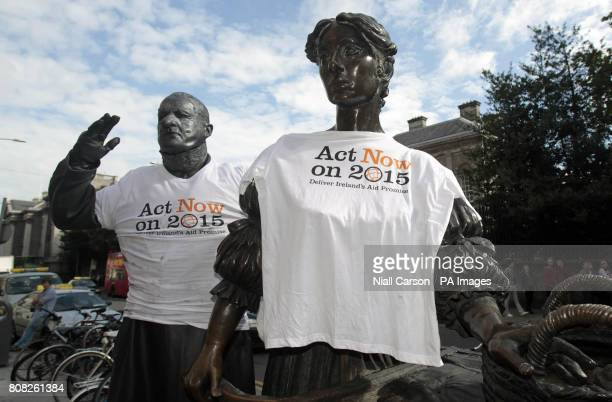 Marcel Dublin's human statue takes part in a photo call by the Molly Malone statue in Grafton Street Dublin for Dochas the association of Irish...
