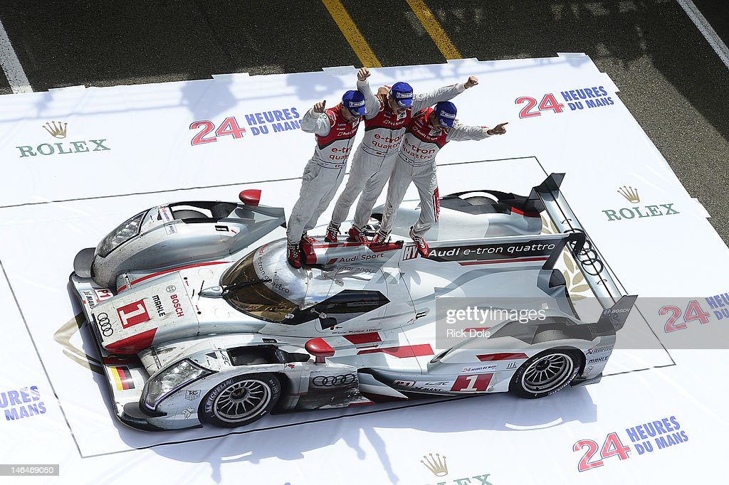 Marcel Fassler of Switzerland, <a gi-track='captionPersonalityLinkClicked' href=/galleries/search?phrase=Andre+Lotterer&family=editorial&specificpeople=2380096 ng-click='$event.stopPropagation()'>Andre Lotterer</a> of Germany, and <a gi-track='captionPersonalityLinkClicked' href=/galleries/search?phrase=Benoit+Treluyer&family=editorial&specificpeople=4333474 ng-click='$event.stopPropagation()'>Benoit Treluyer</a> of France, celebrate in victory lane atop the #1 Audi e-tron quattro after winning the 80th running of the Le Mans 24 Hour race at the Circuit des 24 Heures du Mans on June 17, 2012 in Le Mans, France.