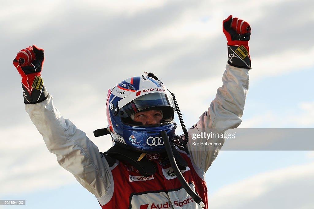 Marcel Fassler of Switzerland celebrates in parc ferme after he and Audi Sport Team Joest R18 team mates Andre Lotterer of Germany and Benoit Treluyer of France win the FIA World Endurance Championship Six Hours of Silverstone race at the Silverstone Circuit on April 17, 2016 in Northampton, England.