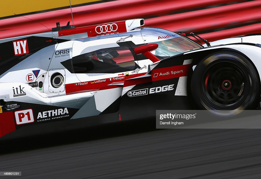 Marcel Fassler of Switzerland drives the #2 Audi Sport Team Joest Audi R18 e-tron quattro LMP1 during practice for the FIA World Endurance Championship 6 Hours of Silverstone sportscar race at the Silverstone Circuit on April 19, 2014 in Northampton, England.