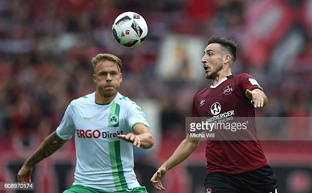 Marcel Franke of Fuerth and Kevin Moehwald of Nuernberg compete for the ball during the Second Bundesliga match between 1 FC Nuernberg and SpVgg...