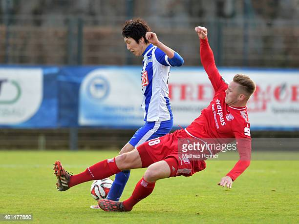 Marcel Franke of Hallescher FC tackles Genki Haraguchi of Hertha BSC during a Friendly Match between Hertha BSC and Hallescher FC on January 13 2015...