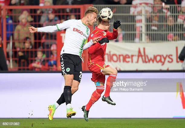 Marcel Franke of SpVgg Greuther Fuerth and Simon Hedlund of 1 FC Union Berlin compete for the ball during the Second Bundesliga match between 1 FC...