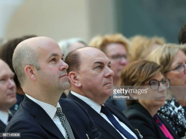 Marcel Fratzscher head of the German Institute for Economic Research in Berlin left sits in the audience beside Axel Weber chairman of UBS Group AG...
