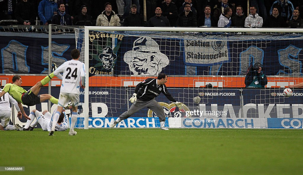Marcel Gaus (L) of Fortuna Duesseldorf scores his first goal against goalkeeper Gabor Kiraly (R) of 1860 Muenchen during the second Bundesliga match between 1860 Muenchen and Fortuna Duesseldorf on February 7, 2011 in Munich, Germany.