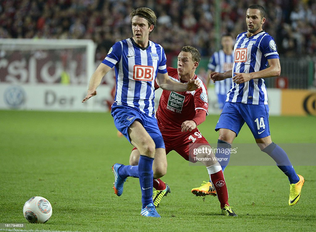 Marcel Gaus (R) of Kaiserslautern battles for the ball with Peter Niemeyer (L) of Berlin during the DFB Cup 2nd round match between 1.FC Kaiserslautern and Hertha BSC Berlin at Fritz-Walter-Stadion on September 25, 2013 in Kaiserslautern, Germany.
