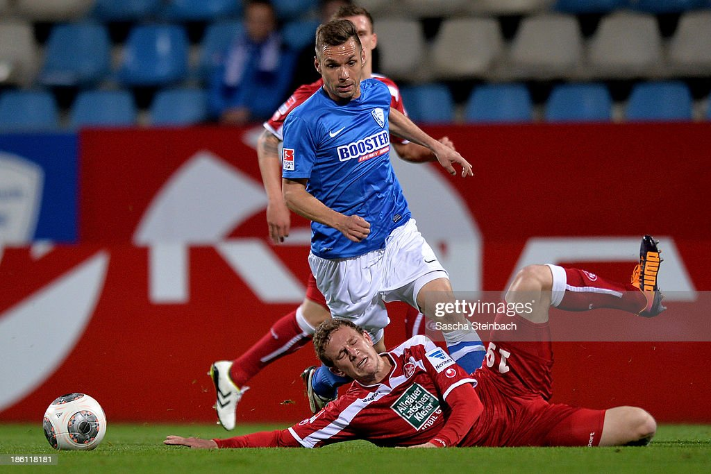 Marcel Gaus of Kaiserslautern is brought down by <a gi-track='captionPersonalityLinkClicked' href=/galleries/search?phrase=Christian+Tiffert&family=editorial&specificpeople=654066 ng-click='$event.stopPropagation()'>Christian Tiffert</a> of Bochum during the Second Bundesliga match between VfL Bochum and 1. FC Kaiserslautern at Rewirpower Stadion on October 28, 2013 in Bochum, Germany.