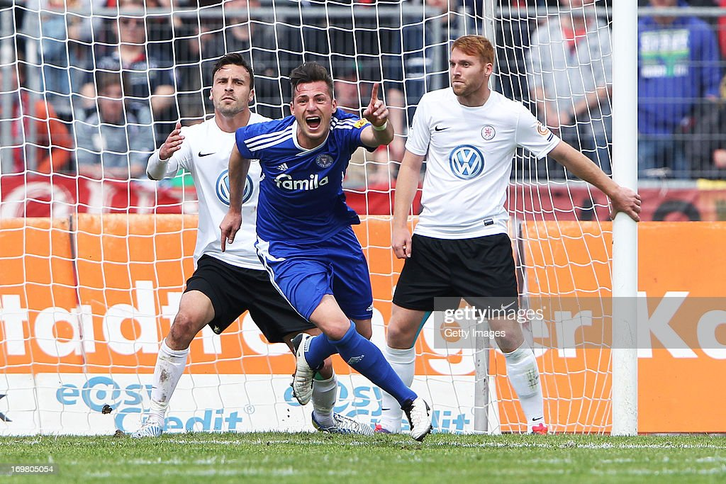 Marcel Gebers of Kiel celebrates after scoring his team's second goal during the Regionalliga Playoff Second Leg match between Hessen Kassel and...