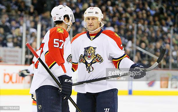 Marcel Goc and Alex Kovalev of the Florida Panthers discuss strategy during a stoppage in play during NHL action against the Winnipeg Jets at the MTS...