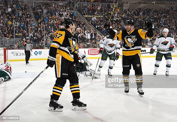 Marcel Goc celebrates his goal with Zach Sill of the Pittsburgh Penguins during the first period against the Minnesota Wild at Consol Energy Center...