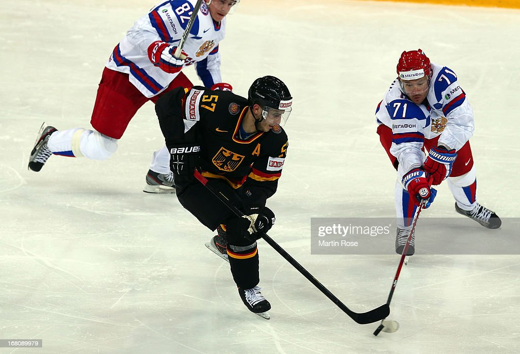 Marcel Goc (L) of Germany and Ilya Kovalchuk (R) of Russia battle for the puck during the IIHF World Championship group H match between Germany and Russia at Hartwall Areena on May 5, 2013 in Helsinki, Finland.