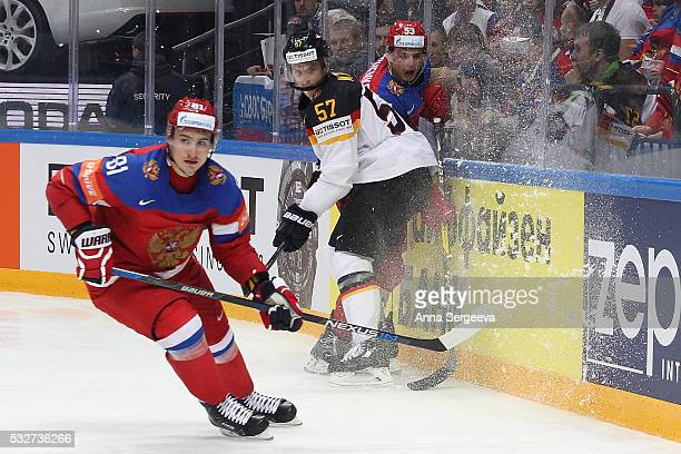 Marcel Goc of Germany checks Alexei Marchenko of Russia at Ice Palace on May 19 2016 in Moscow Russia