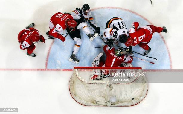 Marcel Goc of Germany scores his team's 4th goal over patrick Galbraith goalkeeper of Denmark during the IIHF World Championship group A match...