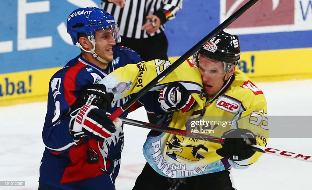<a gi-track='captionPersonalityLinkClicked' href=/galleries/search?phrase=Marcel+Goc&family=editorial&specificpeople=541626 ng-click='$event.stopPropagation()'>Marcel Goc</a> (L) of Mannheim fights with <a gi-track='captionPersonalityLinkClicked' href=/galleries/search?phrase=Christian+Ehrhoff&family=editorial&specificpeople=214788 ng-click='$event.stopPropagation()'>Christian Ehrhoff</a> of Krefeld during the DEL match between Adler Mannheim and Krefeld Pinguine at SAP-Arena on October 12, 2012 in Mannheim, Germany.