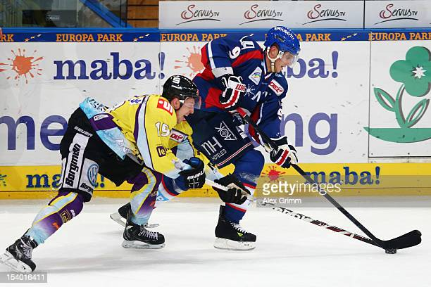 Marcel Goc of Mannheim is challenged by Mark Voakes of Krefeld during the DEL match between Adler Mannheim and Krefeld Pinguine at SAPArena on...