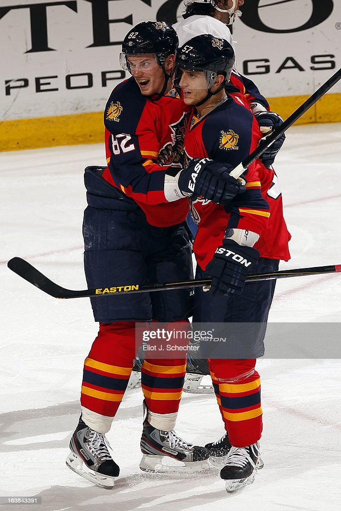 <a gi-track='captionPersonalityLinkClicked' href=/galleries/search?phrase=Marcel+Goc&family=editorial&specificpeople=541626 ng-click='$event.stopPropagation()'>Marcel Goc</a> #57 of the Florida Panthers celebrates his goal with teammate <a gi-track='captionPersonalityLinkClicked' href=/galleries/search?phrase=Tomas+Kopecky&family=editorial&specificpeople=2234349 ng-click='$event.stopPropagation()'>Tomas Kopecky</a> #82 against the New York Islanders at the BB&T Center on March 16, 2013 in Sunrise, Florida.