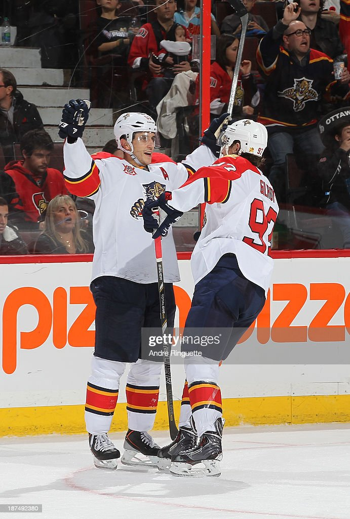 <a gi-track='captionPersonalityLinkClicked' href=/galleries/search?phrase=Marcel+Goc&family=editorial&specificpeople=541626 ng-click='$event.stopPropagation()'>Marcel Goc</a> #57 of the Florida Panthers celebrates his third-period goal against the Ottawa Senators with teammate <a gi-track='captionPersonalityLinkClicked' href=/galleries/search?phrase=Matt+Gilroy&family=editorial&specificpeople=817917 ng-click='$event.stopPropagation()'>Matt Gilroy</a> #97 at Canadian Tire Centre on November 9, 2013 in Ottawa, Ontario, Canada.