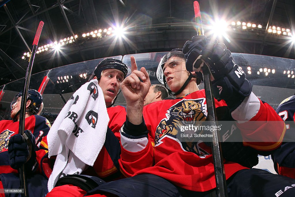 <a gi-track='captionPersonalityLinkClicked' href=/galleries/search?phrase=Marcel+Goc&family=editorial&specificpeople=541626 ng-click='$event.stopPropagation()'>Marcel Goc</a> #57 of the Florida Panthers chats with teammate Shawn Matthias #18 on the bench during a break in the action against the Tampa Bay Lightning at the BB&T Center on February 16, 2013 in Sunrise, Florida.