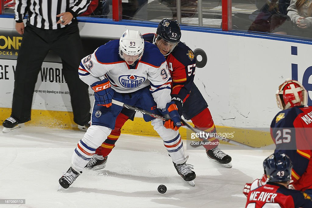 <a gi-track='captionPersonalityLinkClicked' href=/galleries/search?phrase=Marcel+Goc&family=editorial&specificpeople=541626 ng-click='$event.stopPropagation()'>Marcel Goc</a> #57 of the Florida Panthers defends against <a gi-track='captionPersonalityLinkClicked' href=/galleries/search?phrase=Ryan+Nugent-Hopkins&family=editorial&specificpeople=7144190 ng-click='$event.stopPropagation()'>Ryan Nugent-Hopkins</a> #93 of the Edmonton Oilers during overtime at the BB&T Center on November 5, 2013 in Sunrise, Florida. The Oilers defeated the Panthers 4-3 in overtime.