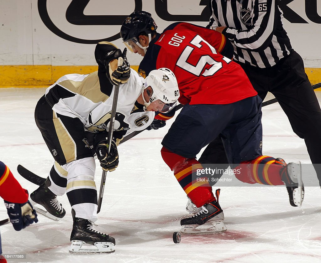 <a gi-track='captionPersonalityLinkClicked' href=/galleries/search?phrase=Marcel+Goc&family=editorial&specificpeople=541626 ng-click='$event.stopPropagation()'>Marcel Goc</a> #57 of the Florida Panthers faces off against <a gi-track='captionPersonalityLinkClicked' href=/galleries/search?phrase=Sidney+Crosby&family=editorial&specificpeople=212781 ng-click='$event.stopPropagation()'>Sidney Crosby</a> #87 of the Pittsburgh Penguins at the BB&T Center on October 11, 2013 in Sunrise, Florida.