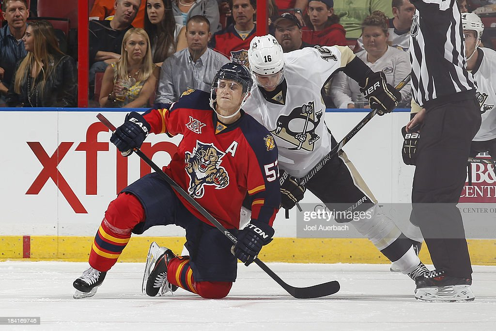 Marcel Goc #57 of the Florida Panthers is taken to the ice by Brandon Sutter #16 of the Pittsburgh Penguins during a power play in the second period at the BB&T Center on October 11, 2013 in Sunrise, Florida.