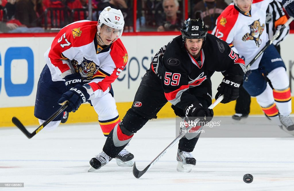 <a gi-track='captionPersonalityLinkClicked' href=/galleries/search?phrase=Marcel+Goc&family=editorial&specificpeople=541626 ng-click='$event.stopPropagation()'>Marcel Goc</a> #57 of the Florida Panthers races to the puck against <a gi-track='captionPersonalityLinkClicked' href=/galleries/search?phrase=Chad+LaRose&family=editorial&specificpeople=546026 ng-click='$event.stopPropagation()'>Chad LaRose</a> #59 of the Carolina Hurricanes during an NHL game on March 2, 2013 at PNC Arena in Raleigh, North Carolina.