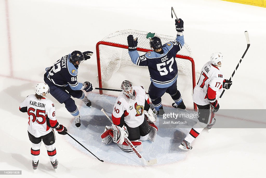 <a gi-track='captionPersonalityLinkClicked' href=/galleries/search?phrase=Marcel+Goc&family=editorial&specificpeople=541626 ng-click='$event.stopPropagation()'>Marcel Goc</a> #57 of the Florida Panthers raises his stick in celebration after scoring a goal past Goaltender <a gi-track='captionPersonalityLinkClicked' href=/galleries/search?phrase=Robin+Lehner&family=editorial&specificpeople=5894610 ng-click='$event.stopPropagation()'>Robin Lehner</a> #40 of the Ottawa Senators on March 4, 2012 at the BankAtlantic Center in Sunrise, Florida.