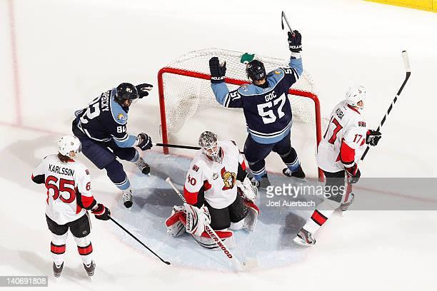 Marcel Goc of the Florida Panthers raises his stick in celebration after scoring a goal past Goaltender Robin Lehner of the Ottawa Senators on March...