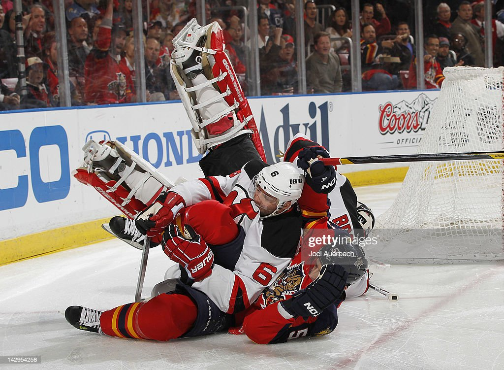<a gi-track='captionPersonalityLinkClicked' href=/galleries/search?phrase=Marcel+Goc&family=editorial&specificpeople=541626 ng-click='$event.stopPropagation()'>Marcel Goc</a> #57 of the Florida Panthers runs into <a gi-track='captionPersonalityLinkClicked' href=/galleries/search?phrase=Andy+Greene&family=editorial&specificpeople=3568726 ng-click='$event.stopPropagation()'>Andy Greene</a> #6 as goaltender <a gi-track='captionPersonalityLinkClicked' href=/galleries/search?phrase=Martin+Brodeur&family=editorial&specificpeople=201594 ng-click='$event.stopPropagation()'>Martin Brodeur</a> #30 of the New Jersey Devils also falls to the ice in Game Two of the Eastern Conference Quarterfinals during the 2012 NHL Stanley Cup Playoffs at the BankAtlantic Center on April 15, 2012 in Sunrise, Florida.