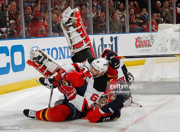 Marcel Goc of the Florida Panthers runs into Andy Greene as goaltender Martin Brodeur of the New Jersey Devils also falls to the ice in Game Two of...