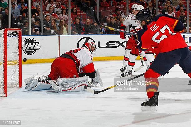 Marcel Goc of the Florida Panthers scores a goal past Goaltender Brian Boucher of the Carolina Hurricanes during the first period on April 7 2012 at...