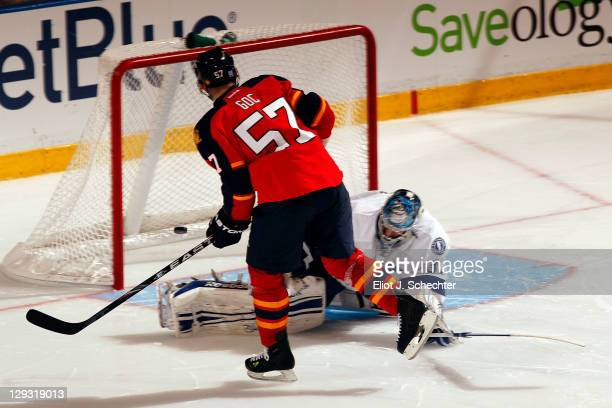 Marcel Goc of the Florida Panthers scores the gamewinning shootout goal against goaltender Mathieu Garon of the Tampa Bay Lightning at the...
