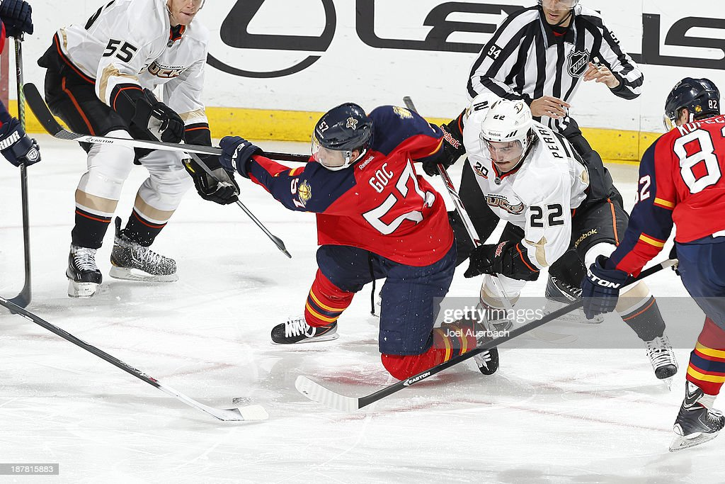 <a gi-track='captionPersonalityLinkClicked' href=/galleries/search?phrase=Marcel+Goc&family=editorial&specificpeople=541626 ng-click='$event.stopPropagation()'>Marcel Goc</a> #57 of the Florida Panthers shoots the puck as he is checked by <a gi-track='captionPersonalityLinkClicked' href=/galleries/search?phrase=Mathieu+Perreault&family=editorial&specificpeople=776813 ng-click='$event.stopPropagation()'>Mathieu Perreault</a> #22 of the Anaheim Ducks at the BB&T Center on November 12, 2013 in Sunrise, Florida. The Panthers defeated the Ducks 3-2.