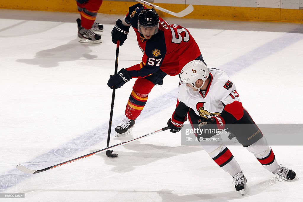 <a gi-track='captionPersonalityLinkClicked' href=/galleries/search?phrase=Marcel+Goc&family=editorial&specificpeople=541626 ng-click='$event.stopPropagation()'>Marcel Goc</a> #57 of the Florida Panthers skates with the puck against <a gi-track='captionPersonalityLinkClicked' href=/galleries/search?phrase=Peter+Regin&family=editorial&specificpeople=690589 ng-click='$event.stopPropagation()'>Peter Regin</a> #13 of the Ottawa Senators at the BB&T Center on April 7, 2013 in Sunrise, Florida.