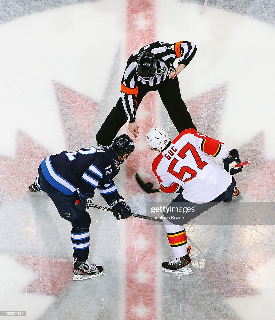 <a gi-track='captionPersonalityLinkClicked' href=/galleries/search?phrase=Marcel+Goc&family=editorial&specificpeople=541626 ng-click='$event.stopPropagation()'>Marcel Goc</a> #57 of the Florida Panthers wins a second period face-off against <a gi-track='captionPersonalityLinkClicked' href=/galleries/search?phrase=Olli+Jokinen&family=editorial&specificpeople=202946 ng-click='$event.stopPropagation()'>Olli Jokinen</a> #12 of the Winnipeg Jets at the MTS Centre on April 11, 2013 in Winnipeg, Manitoba, Canada.