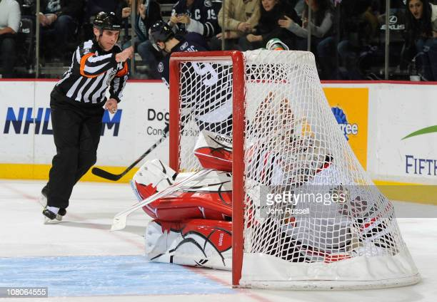 Marcel Goc of the Nashville Predators scores as goalie Corey Crawford of the Chicago Blackhawks goes in the net with the puck during a shootout in an...