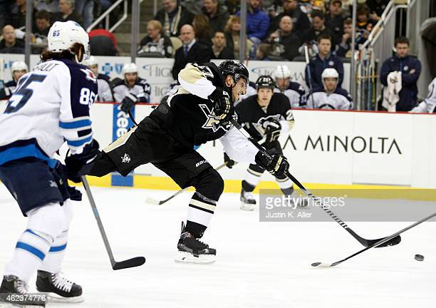 Marcel Goc of the Pittsburgh Penguins shoots in the first period against the Winnipeg Jets during the game at Consol Energy Center on January 27 2015...