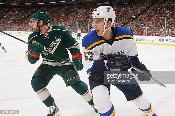 Marcel Goc of the St Louis Blues and Justin Fontaine of the Minnesota Wild skate to the puck in Game Three of the Western Conference Quarterfinals...