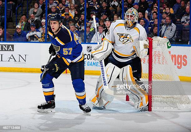 Marcel Goc of the St Louis Blues skates in front of Carter Hutton of the Nashville Predators on January 29 2015 at Scottrade Center in St Louis...