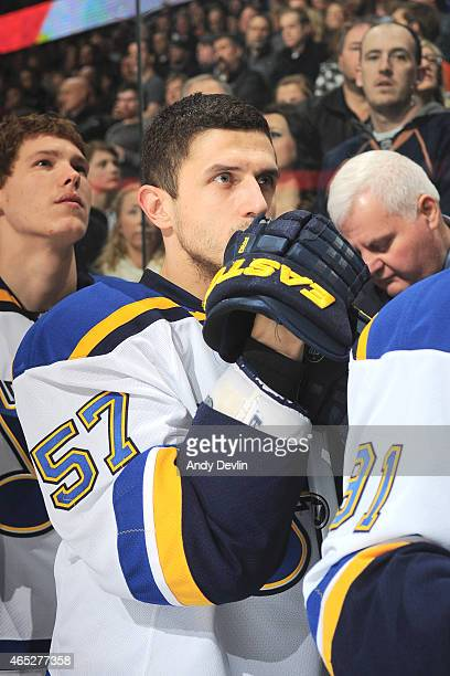 Marcel Goc of the St Louis Blues stands for the singing of the national anthem prior to the game against the Edmonton Oilers on February 28 2015 at...